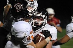 Photo Credit: PAMPLIN MEDIA: DAVID BALL - Beavertons Carter Olsen is greeted along the sideline by teammate Tovey Brown, 55, after coming up with the clinching interception in the final minute Friday.