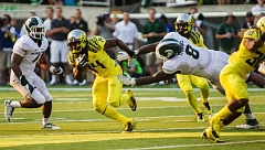 Photo Credit: COURTESY OF DAVID BLAIR - Ifo Ekpre-Olomu tries to avoid a Michigan State tackler as the Oregon Ducks beat the Spartans 46-27 Saturday at Autzen Stadium.