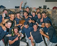 Photo Credit: PAMPLIN MEDIA GROUP: CHASE ALLGOOD - The Hillsboro Hops celebrate their Northwest League title after a clinching, 4-3 victory Sunday night at home against the Vancouver Canadians.