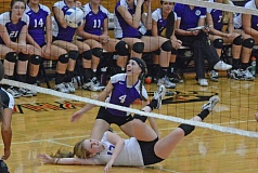 Photo Credit: TIMES PHOTO: MATT SINGLEDECKER - Sunset senior Laurie Salness and sophomore Reilly Schreck go after a loose ball early in the first set of the Apollos five-set victory over Southridge on Tuesday.