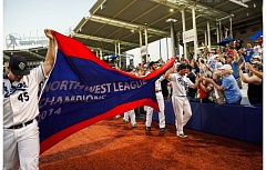 Photo Credit: PAMPLIN MEDIA GROUP: CHASE ALLGOOD - The Hillsboro Hops celebrate their Northwest League championship with fans at Ron Tonkin Field.