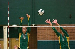 Photo Credit: TRIBUNE PHOTO: JONATHAN HOUSE - Clevelands Taylor Ristvedt (left) and Zoe Lequeux go up for a block in the Warriors 3-2 volleyball victory at Wilson.