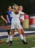 Photo Credit: VERN UYETAKE - Lake Oswego's Cami Dozois and Libby Dozois celebrate after Libby scores the first goal of the game in the Lakers' 2-0 victory over Gresham.