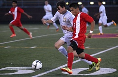 Photo Credit: PAMPLIN MEDIA: DAVID BALL - Milwaukies Vance Quarton, 13, chases a ball in front of Centennial midfielder Jorge Perez during the Mustangs 3-2 win in Thursdays season opener.