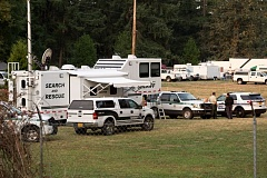 Photo Credit: ESTACADA NES: TROY WAYRYNEN - Local emergency agencies set up at an incident command center at Timber Park in Estacada, Oregon. Fire fighters use the park as a rest area as they help contain a forest fire.