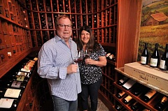 Photo Credit: TIDINGS PHOTO: VERN UYETAKE - Michael and Lisa Noel have quite a collection of wine at their West Linn home. Among the bottles is their very own label - Noel Family Vineyards. The vineyard, located in Newberg, produces up to 125 cases of pinot noir each year.