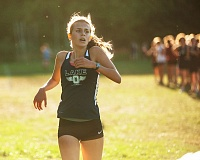 Photo Credit: JOSH KULLA - Lake Oswego freshman Grace David checks her time after crossing the finish line after winning last week's race.