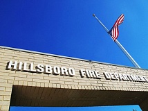 Photo Credit: HILLSBORO TRIBUNE PHOTOS: KATHY FULLER - A flag flies at half-staff over the Hillsboro Fire Departments station on 299th Avenue on Sept. 11.