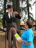 Photo Credit: HILLSBORO TRIBUNE PHOTO: KATHY FULLER - Hillsboro resident Susan Serres chats with 19th century man outside the Shute Park Library during the kick-off of Fair Shot Oregon, an advocacy group promoting fair pay and paid sick days for Oregons women and working families.