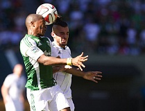 Photo Credit: TRIBUNE PHOTO: JAIME VALDEZ - Darlington Nagbe (left) of the Portland Timbers and Russell Teibert of the Vancouver Whitecaps head the ball Saturday afternoon at Providence Park.