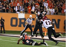Photo Credit: COURTESY OF BRUCE MCCAIN - Oregon State quarterback Sean Mannion beats the rush to get off a pass Saturday night at home against San Diego State.