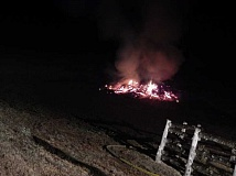 Photo Credit: COURTESY OF TUALATIN VALLEY FIRE & RESCUE  - A 50-foot-by-50-foot burn pile near a barn flamed up Monday night.