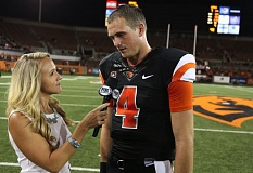 Photo Credit: COURTESY OF BRUCE R. MCCAIN - Oregon State quarterback Sean Mannion (right) gets a postgame interview on Fox Sports 1 after leading the Beavers past San Diego State.