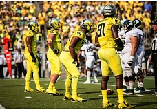 Photo Credit: COURTESY OF DAVID BLAIR - The Oregon Ducks line up on defense against Michigan State: (from left) Arik Armstead, Alex Balducci, DeForest Buckner and Tony Washington.