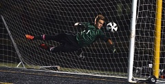 Photo Credit: TIMES PHOTO: MATT SINGLEDECKER - Southridge senior goalie Grant Garcia saved six shots and helped keep the Skyhawks in the match against Oregon City on Monday in a 2-0 loss.
