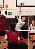 Photo Credit: DAN BROOD - Lake Oswego's Audrey Treske places a shot over the net in Lake Oswego's three-set victory over Sherwood on Monday.