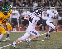 Photo Credit: MATTHEW SHERMAN - Lake Oswego's Max Mattern breaks into the secondary against West Linn in last week's game. Mattern had over 100 yards rushing in the contest and his team's only touchdown.