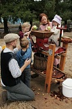 Photo Credit: CONTRIBUTED BY JANIE DAMON - Visitors enjoyed learning about history while pressing cider during Philip Foster Farms 39th Annual Cider Squeeze Saturday, Sept. 27.