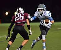 Photo Credit: VERN UYETAKE - Lakeridge receiver Jack Cole looks to put a stiff-arm on a Sherwood defender during last week's game.