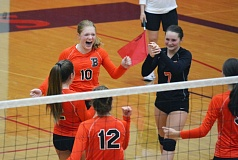 Photo Credit: TIMES PHOTO: MATT SINGLEDECKER - Beaverton's Sarah Tantare and Mylee Crouse celebrate a Beaver point in the second set of Beaverton's sweep of Westview on Thursday.