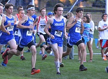 Photo Credit: TIMES PHOTO: MATT SINGLEDECKER - The Valley Catholic boys cross country team, led by Aiden Gillespie and Nathaniel Trobough, helped the Valiants take first at the Southwest Christian Invitational on Friday.