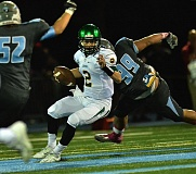 Photo Credit: VERN UYETAKE - West Linn quarterback Tim Tawa avoids a pair of Lakeridge tacklers during last week's 35-7 victory. Tawa threw for three touchdown passes and ran for another in the game.
