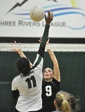 Photo Credit: MATTHEW SHERMAN - West Linn's Hannah Clarke looks to make a block in the Lions' four-set victory over Tigard on Monday.
