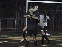 Photo Credit: MATTHEW SHERMAN - Lauren Gilbert gets a celebratory hug after scoring Lake Oswego's first goal against West Linn late in the first half.