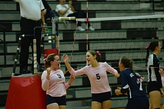 Photo Credit: COREY BUCHANAN - Madison Wardle (left) and Lexy Thompson celebrate after winning a big point during the match.