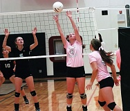 Photo Credit: DAN BROOD - SETTING IT UP -- Tualatin High School senior Natalie Anderson (6) sets the ball for senior Tegan Bracha in Monday's Three Rivers League match against Lakeridge. The Pacers won in three sets.