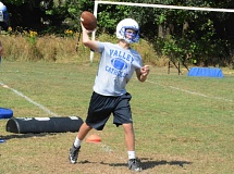 Photo Credit: TIMES FILE PHOTO - Valley Catholic sophomore quarterback Aidan Welsh threw for 330 yards against Astoria.