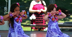 Photo Credit: COURTESY PHOTO - Lisa Changs hula classes are for all ages. Lilinoe Pai (left) and Clare Hildick Klein danced at the Beaverton International Celebration.