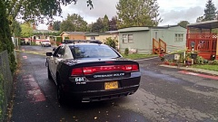 Photo Credit: KOIN 6 NEWS - Police at the scene of a homicide at the Bell Acre Mobile Home Park in Gresham.