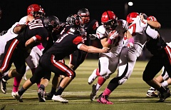 Photo Credit: DAVID BLAIR - Oregon City junior running back Conner Mitchell (7) rushed for 129 yards in last weeks Pioneer victory, but the yardage did not come easy.