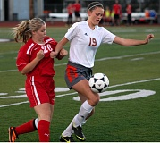 Photo Credit: DAVID BALL - Gladstone junior forward Allie Nordby (19) gets the jump on Corbett sophomore Josie Fort in last weeks game with the Cardinals. Gladstone won 1-0 and remained in the hunt for the Tri-Valley Conference title with the victory.