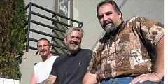 Photo Credit: BILL MINTIENS - Left to right: Bryan (also living at Redemption House Ministries), Matt Kallunki, and Greg Sanders, RHM director, sitting outside local homeless shelter.