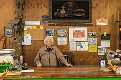 Photo Credit: RAY HUGHEY - Betty Faist has been working the counter of her produce stand for 47 years, something she's enjoyed tremendously. But, come Saturday, an 80-year institution will close its doors as Betty and her husband Larry will retire.