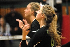 Photo Credit: ESTACADA NEWS: DAVID BALL - Estacadas Tori Johnson and Maddi Thompson get set in the front row during the opening set of Tuesdays four-set loss to Madras.