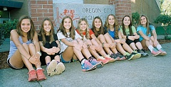 Photo Credit: JOHN DENNY - Oregon City High Schools girls cross country team has taken the Mt. Hood Conference by storm this fall. Despite a youthful lineup, the Pioneers went undefeated in league dual competition. Pictured are team members (from left): Miranda Nelson, Kaari Guelsdorf, Kylie Guelsdorf, Allie Edwards, Shiloh Najjar, Rebecca Blackwood, Jenna Beyer and Corina Stilwell.