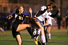 Photo Credit: JAIME VALDEZ -   Gladstones Ali Petruzzi (left) and Molallas Chase Rome do battle in last weeks showdown between the two Class 4A state soccer powers.
