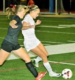 Photo Credit: SETH GORDON - First touch - Sophomore Maddie Whalen beats a Sherwood player to the ball to thwart a Bowmen attack during Newberg's 1-0 victory Oct. 16. The win left the Tigers one game behind Sherwood for second place in the Three Rivers League.