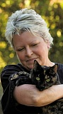 Photo Credit: RAY HUGHEY - Aurora resident Leslie Birrenkott and her fellow cat-lovers have formed a group called Meow Village, which works to rescue feral cats in the area.