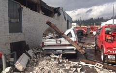 Photo Credit: COURTESY KOIN 6 NEWS - A tornado damaged Carl's Towing in Longview, Wash., on Thursday.