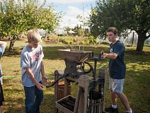 Photo Credit: SPOKESMAN PHOTO: JOSH KULLA - This old-fashioned cider press was one of the top attractions of the harvest festival at the CREST farm Oct. 17.