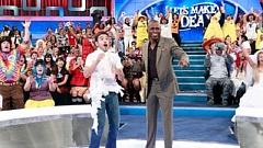 Photo Credit: COURTESY OF 'LET'S MAKE A DEAL' - Meeting Wayne Brady (right), host of the television show 'Let's Make a Deal,' was one of the highlights of appearing on the show in June for local residents Megan and Timothy Love.