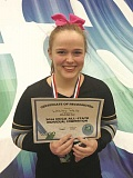 Photo Credit: SUBMITTED PHOTO: CHRISTINE COOPER - Wesley Wells does her team proud at the Oregon Cheerleading Coaches Associations All-State Individual and Stunt Competition.