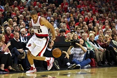 Photo Credit: TRIBUNE PHOTO: JAIME VALDEZ - Trail Blazers forward Nicolas Batum dribbles behind his back after a steal, as Portland goes on the attack Wednesday night at home versus Oklahoma City.