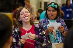 Photo Credit: THE OUTLOOK:TROY WAYRYNEN - Fourth grade students Jane Edwards, 9, left, and Mia Fajardo, 10, experience what it is like having a speech impediment during a disability awareness activity at West Gresham Elementary School. Students were asked to communicate with other students with marshmallows in their mouth.