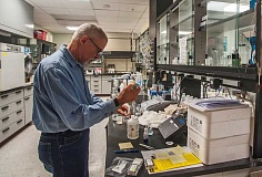 Jim Nail, a lab analyst with CH2M Hill, works with water samples in the lab at Wilsonvilles new wastewater treatment plant.