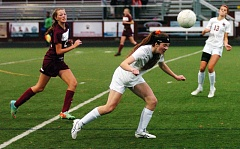 Photo Credit: DAN BROOD - Sherwood sophomore Daria Brandt gets her head on the ball during Saturday's state playoff match.